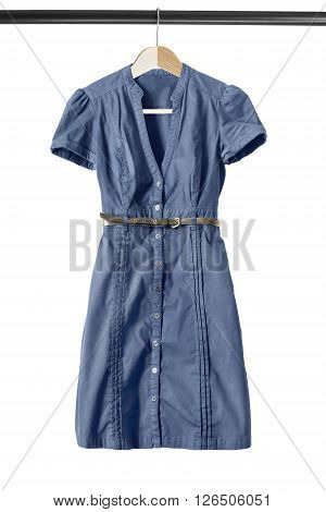 Blue buttoned shirt dress on clothes rack isolated over white