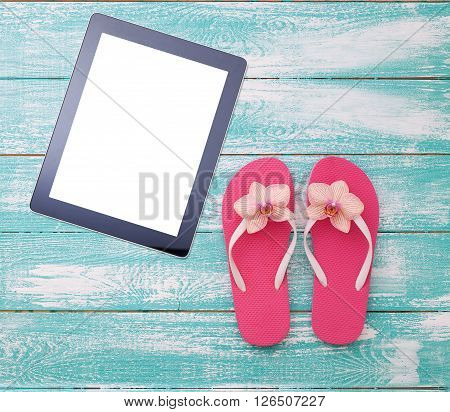 Blank empty tablet computer on beach. Trendy summer accessories on wooden background pool. Flip-flops on beach. Tropical flower orchid. Flat mock up for design. Top view. square