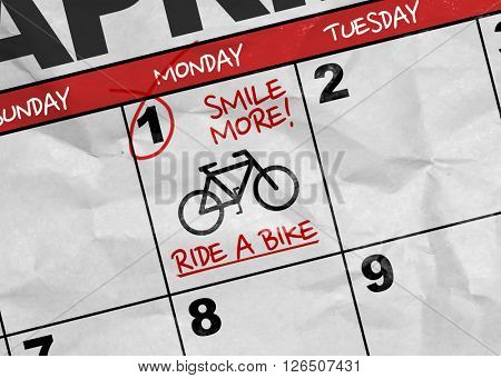Concept image of a Calendar with the text: Smile More! Ride a Bike.