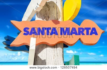 Santa Marta signpost with beach background