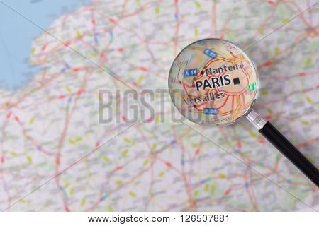 Consultation With Magnifying Glass Map Of Paris