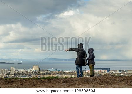 Two unidentified females on the viewpoint of Calton Hill in Edinburgh.