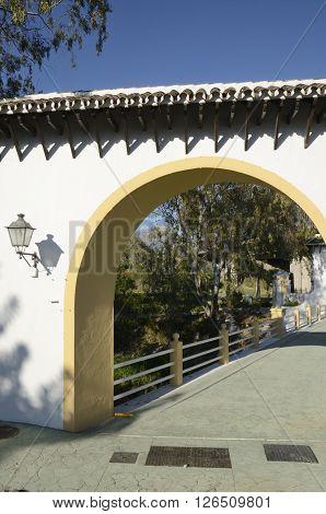 Arch over  a little bridge in Marbella Spain