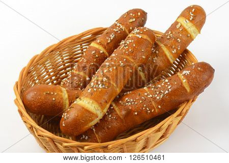 scuttle of fresh bread rolls on white background - close up
