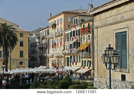 CORFU GREECE - APRIL 18 2009: Buildings dressed with red banners in anticipation of the Resurrection on the morning of Holy Saturday.