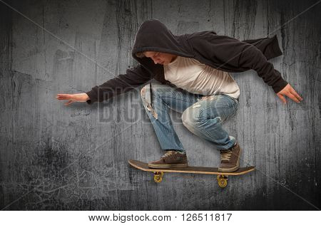 Skateboarder doing trick in mid air