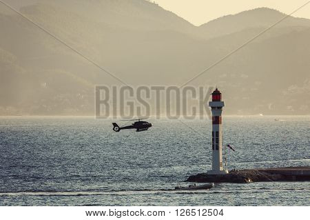 Lighthouse and landing helicopter in Cannes. Cannes Provence-Alpes-Cote d'Azur France