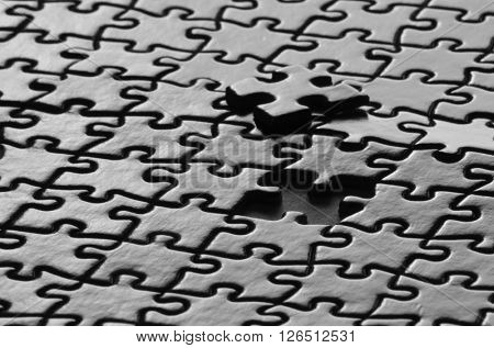 Several puzzle pieces put together symbolizing success and completion of a project