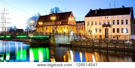 KLAIPEDA, LITHUANIA - 11 APRIL 2016: Early morning over the Old Town district. Danes river quay. Klaipeda, Lithuania.