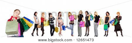 """Group of Eleven shopping girls with happy and relaxed one at the front  - See similar images of this """"Gorgeous shopping women"""" series in my portfolio"""