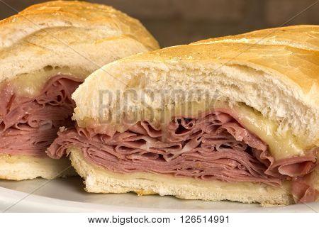 Mortadella traditional Italian sausage sandwich. Wood background