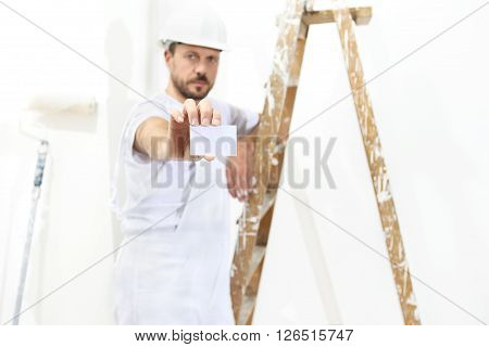 painter man hand with business card ladder on white wall background