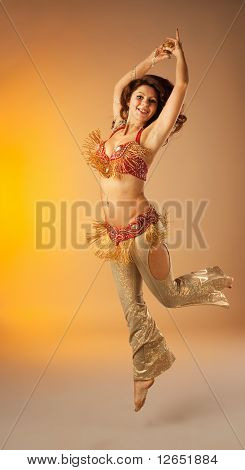 woman jump in dance with finger cymbals