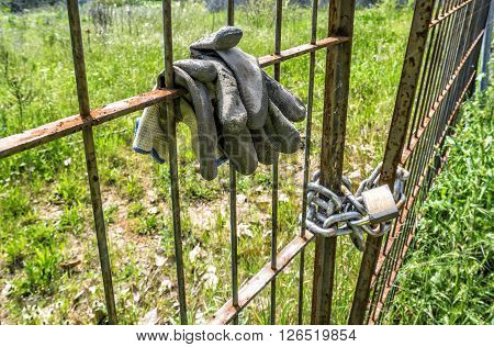 Metal old fence closed with padlock and security chain