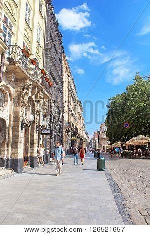 LVIV, UKRAINE - JULY 17, 2015: Market square - historical and tourist centre of the town in Lviv, Ukraine. Historical centre of Lviv is UNESCO World Heritage Site