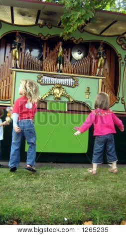 Girls/Children Dancing To A Barrel Organ