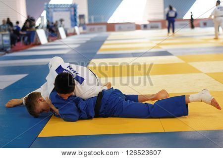 ST. PETERSBURG, RUSSIA - APRIL 16, 2016: Fight Genki Koga of Japan vs Matthijs Van Harten of Netherlands during the Junior European Judo Cup. Athletes from 22 countries participated in the competition