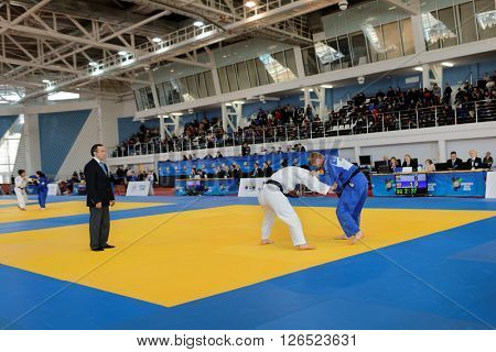 ST. PETERSBURG, RUSSIA - APRIL 16, 2016: Match Khaiyomiddin Zhabborov of Tajikistan (white) vs Roy Schipper of Netherlands during the Junior European Judo Cup