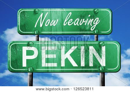 Now leaving pekin road sign with blue sky