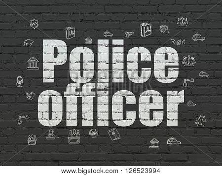 Law concept: Police Officer on wall background
