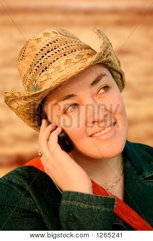 Girl Talking On A Cellphone At Sunset