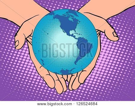 Planet Earth in hands pop art retro style. Earth day, environment Day. Ecology and nature. male hands. South and North America
