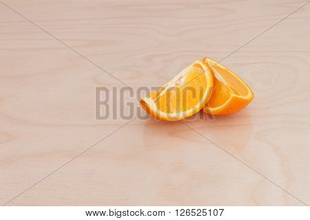 Slices of orange on a chopping Board