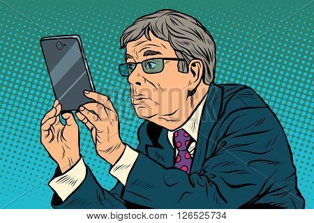 The funny man taking pictures with smartphone pop art retro style. The elderly and gadgets. New technologies. Selfie