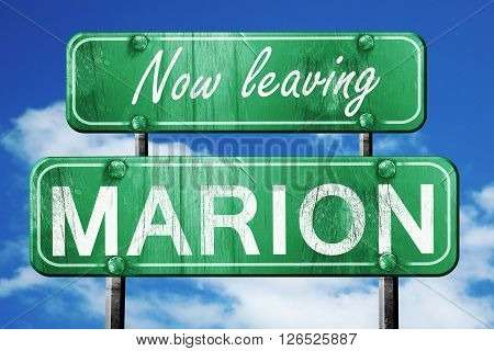 Now leaving marion road sign with blue sky