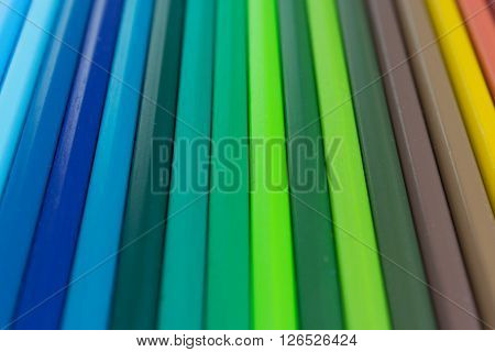 multicolored striped background - assorted color pencils