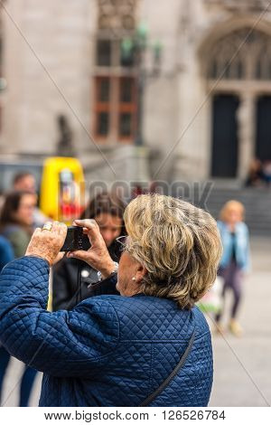 Woman Is Taking Pictures On The Street Of Bruges