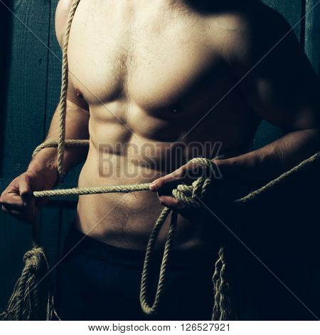 Muscular Man Holding Rope