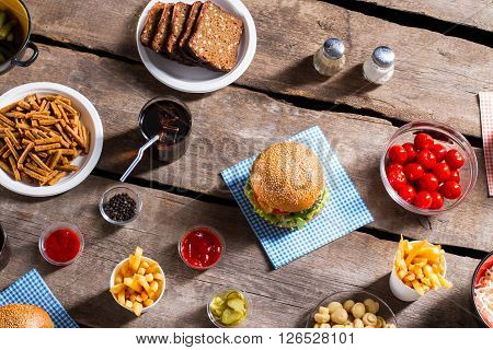 Crackers with bread and burgers. Table with bread and hamburgers. Get rid of your hunger. Weekend meal for a family.