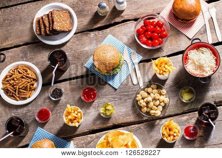 Bread and sauerkraut with burgers. Products and vegetables on table. Sign of hospitality. Vacation meal for every taste.
