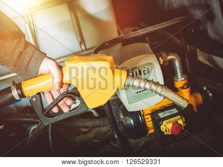 Small Gasoline or Diesel Pump at the Farm. Fuel Nozzle in the Farmer Hand.