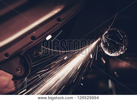 Metal Works Cutting Machine in Action. Metal Pipe Cutting with Sparks. Construction Theme.