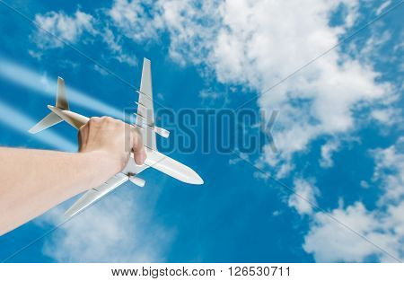 The Dream of Flight. Air Travel Idea Photo Concept with Airliner Airplane Model in a Hand. Business Flights.