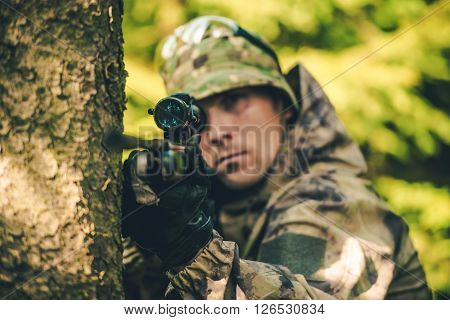 Wildlife Hunter with Rifle Spotting Deer. Hunter Poacher Concept Photo.