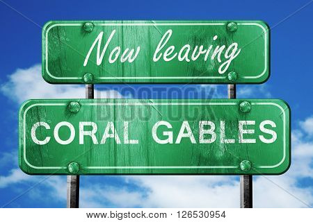 Now leaving coral gables road sign with blue sky