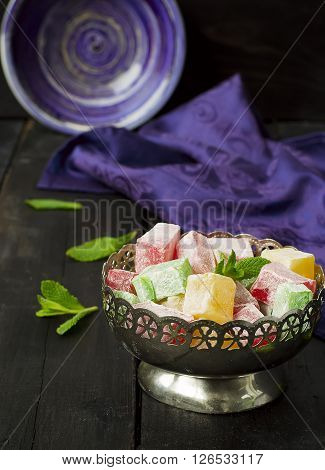 lokum - traditional Turkish sweets on a dark background