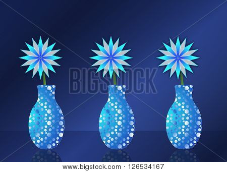 Greeting card design. Row of three blue abstract star shaped flowers in blue vase with white dots. Vase is mirrored on blue table. Blue and navy gradient background.