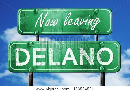 Now leaving delano road sign with blue sky