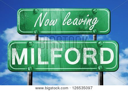 Now leaving milford road sign with blue sky