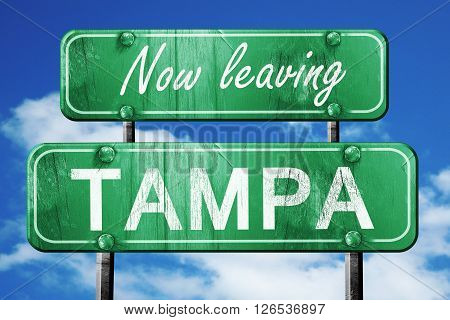 Now leaving tampa road sign with blue sky