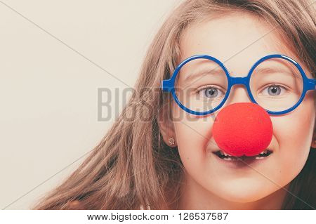 Little girl with red nose. Prepare to have fun carnival time