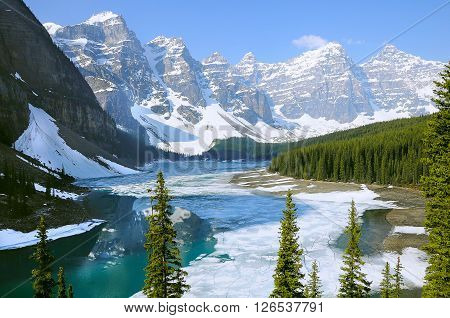 Moraine lake under the ice at spring morning. Banff National park. Canada.