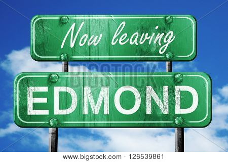 Now leaving edmond road sign with blue sky