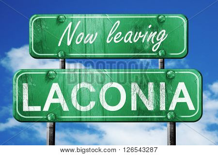 Now leaving laconia road sign with blue sky