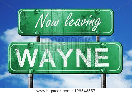 Now leaving wayne road sign with blue sky