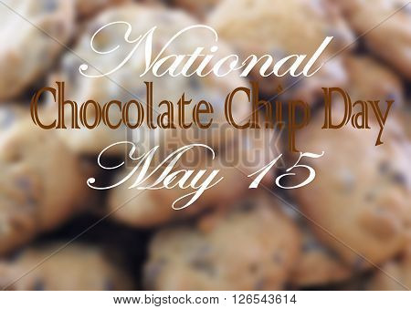 Background blur of a stack of freshly baked chocolate chip cookies with side light and message for chocolate chip day